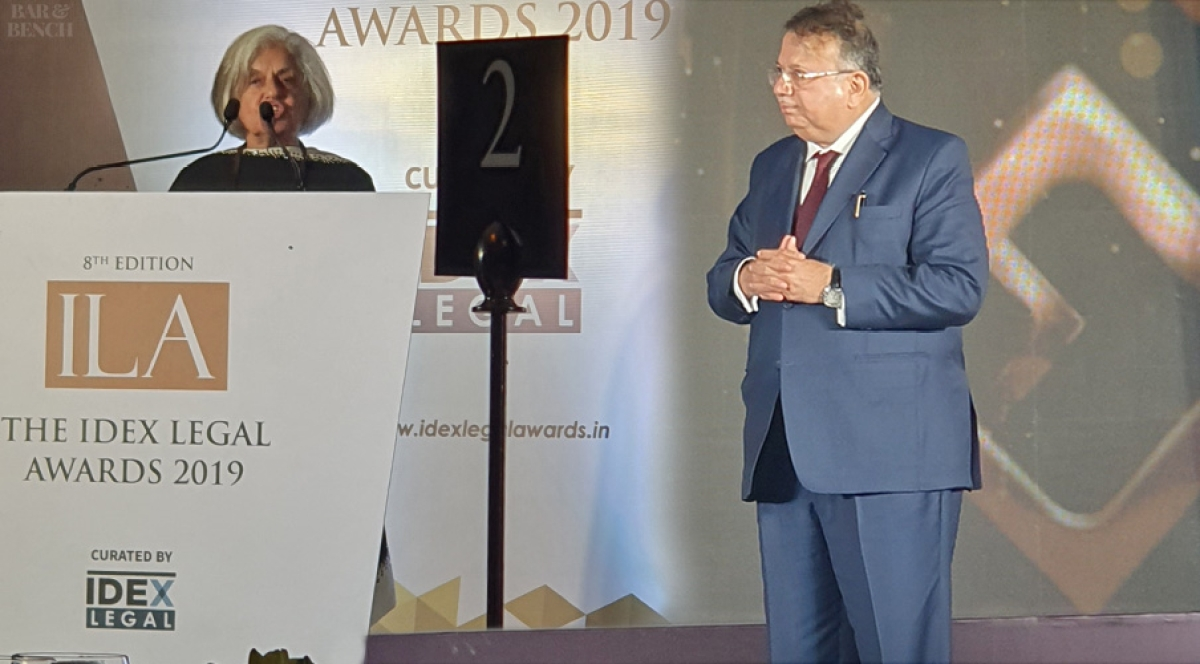 Justice AP Shah looks on while Indira Jaising speaks at the Awards ceremony