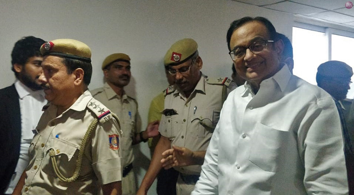 P Chidambaram (R) being escorted by the police in the Rouse Avenue Court Complex, Delhi