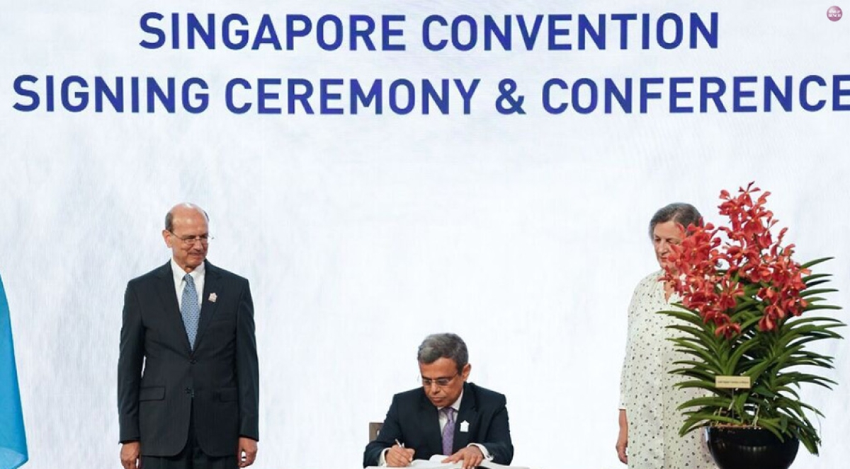 High Commissioner of India to Singapore Jawed Ashraf signs the Singapore Convention