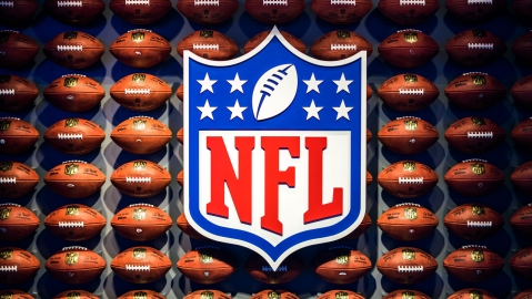 NFL logo with footballs