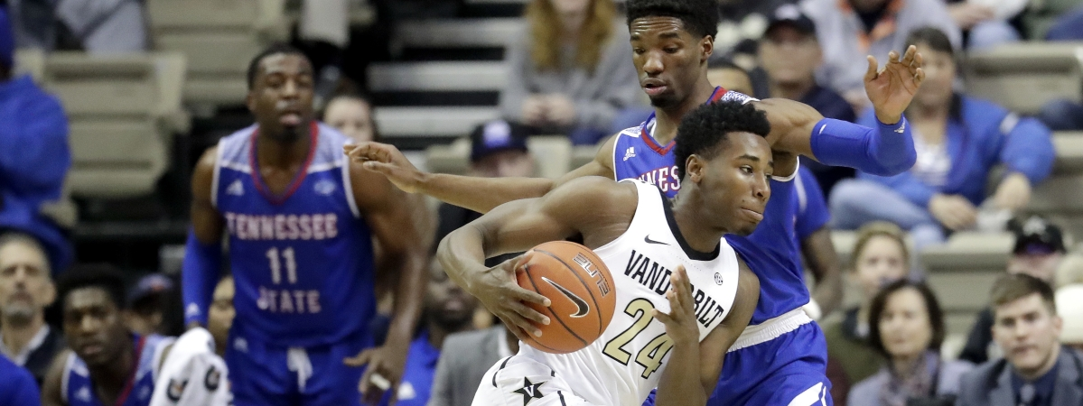 Vanderbilt forward Aaron Nesmith (24) drives against Tennessee State guard Donte Fitzpatrick-Dorsey in the first half of an NCAA college basketball game Saturday, Dec. 29, 2018, in Nashville, Tenn. (AP Photo/Mark Humphrey)