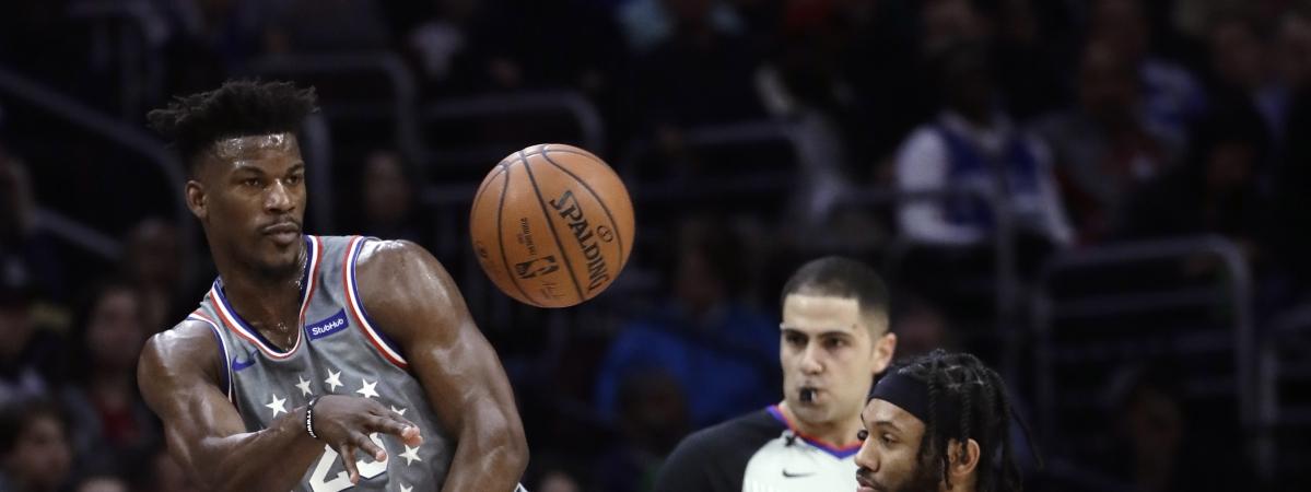 Sixers'  Jimmy Butler makes an assist in a January game (Matt Slocum)