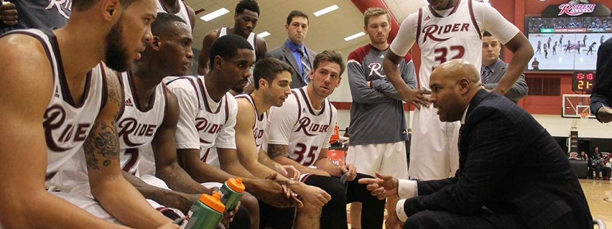 Coach Kevin Baggett and the Rider men's basketball team.