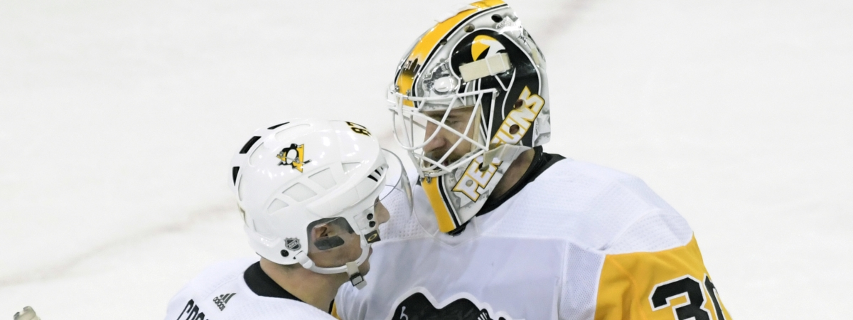 Pittsburgh Penguins goaltender Matt Murray (30) celebrates with Sidney Crosby (87) after the Penguins defeated the New York Rangers 7-2 in an NHL hockey game Wednesday, Jan. 2, 2019, at Madison Square Garden in New York. (AP Photo/Bill Kostroun)