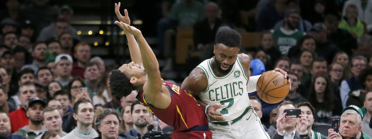 Boston Celtics guard Jaylen Brown (7) drives into Cleveland Cavaliers guard Cameron Payne (3) during the first half of an NBA basketball game, Wednesday, Jan. 23, 2019, in Boston. (AP Photo/Mary Schwalm)