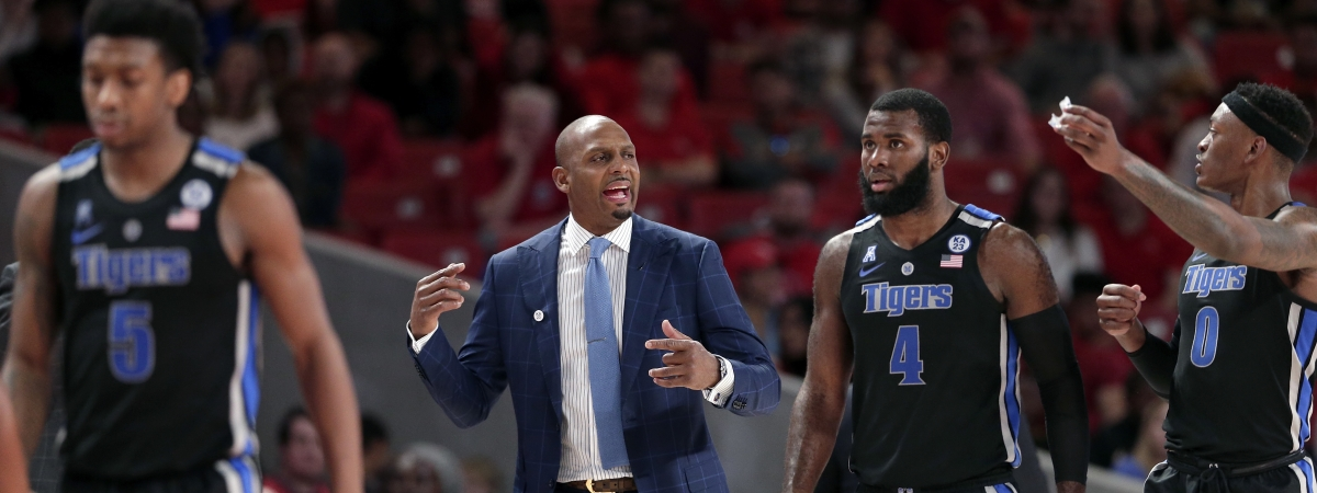 Memphis head coach Penny Hardaway, middle, talks to his players guard Kareem Brewton Jr. (5), guard Raynere Thornton (4) and forward Kyvon Davenport (0) after a time out during the second half of an NCAA college basketball game against Houston Sunday, Jan. 6, 2019, in Houston. (AP Photo/Michael Wyke)