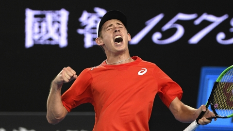 Australia's Alex de Minaur celebrates at the Australian Open in January. He plays Tuesday in the Madrid Open. (AP Photo/Andy Brownbill)