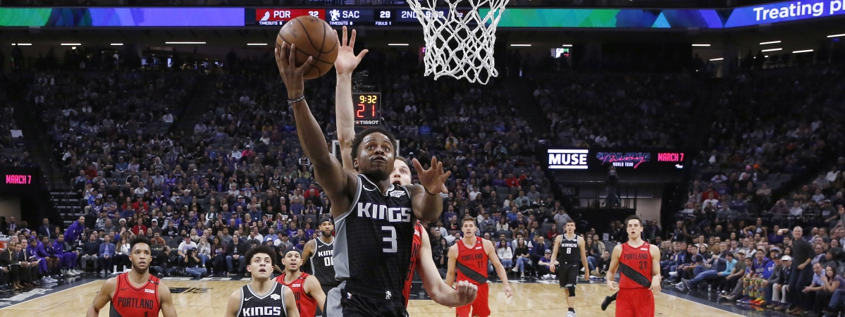 Sacramento Kings guard Yogi Ferrell goes to the basket ahead of Portland Trail Blazers guard Nik Stauskas, behind, during the first half of an NBA basketball game Tuesday, Jan. 1, 2019, in Sacramento, Calif. (AP Photo/Rich Pedroncelli)