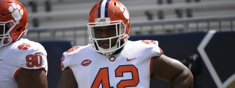 FILE - In this Sept. 22, 2018, file photo, Clemson defensive lineman Christian Wilkins (42) warms up before the first half of an NCAA college football game between Georgia Tech and Clemson, in Atlanta. Wilkins is grateful for the journey he has taken during his final college season. But he says he hasn't reached his destination yet. The second-ranked Tigers take on No. 1 Alabama for the national title on Monday night, Jan. 7, 2019. (AP Photo/Jon Barash, File)
