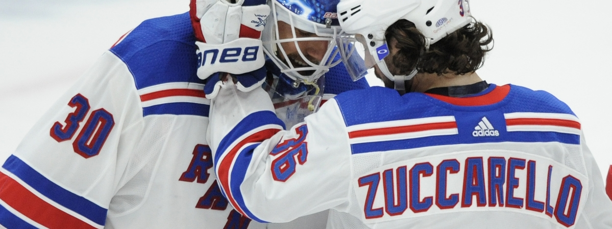 New York Rangers goalie Henrik Lundqvist (30), of Sweden, is congratulated by Mats Zuccarello (36), of Norway, after the team's 2-1 victory over the St. Louis Blues in an NHL hockey game Monday, Dec. 31, 2018, in St. Louis. (AP Photo/Bill Boyce)