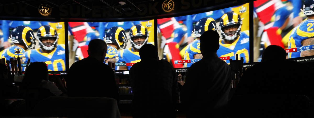 People watch Super Bowl LIII at the Westgate Superbook sports book, Sunday, Feb. 3, 2019, in Las Vegas. (AP Photo/John Locher)
