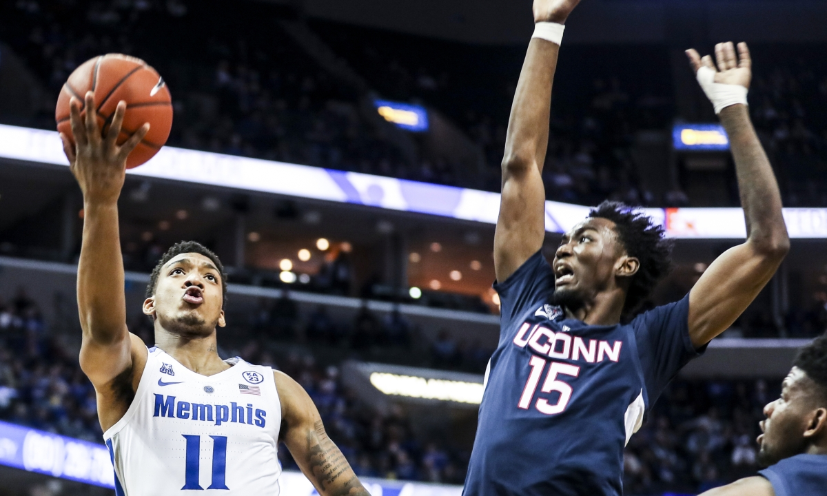 Memphis' Antwann Jones Jr., goes up for a shot against UConn's Sidney Wilsonin February. If UConn moves back to the Big East they'll be back playing St. John's, Villanova and Georgetown. (Brad Vest/The Commercial Appeal via AP)