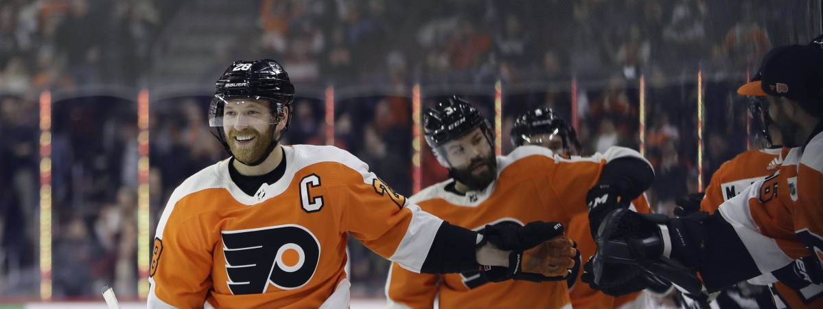 Philadelphia Flyers' Claude Giroux, left, celebrates with teammates after scoring a goal during the first period of an NHL hockey game against the Minnesota Wild, Monday, Jan. 14, 2019, in Philadelphia. (AP Photo/Matt Slocum)
