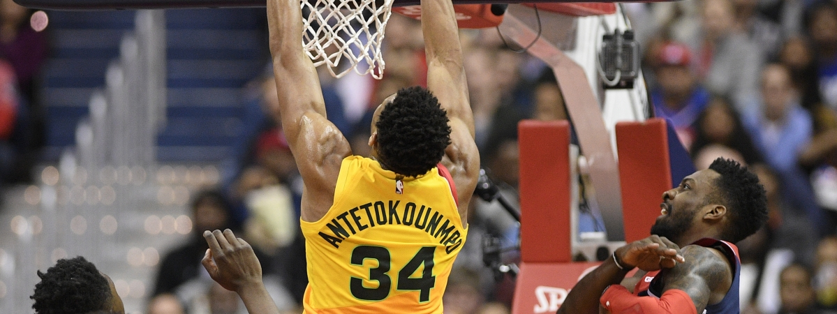 Milwaukee Bucks forward Giannis Antetokounmpo (34) dunks against Washington Wizards forward Jeff Green, right, during the first half of an NBA basketball game, Saturday, Feb. 2, 2019, in Washington. Green was called for a foul on the play. (AP Photo/Nick Wass)
