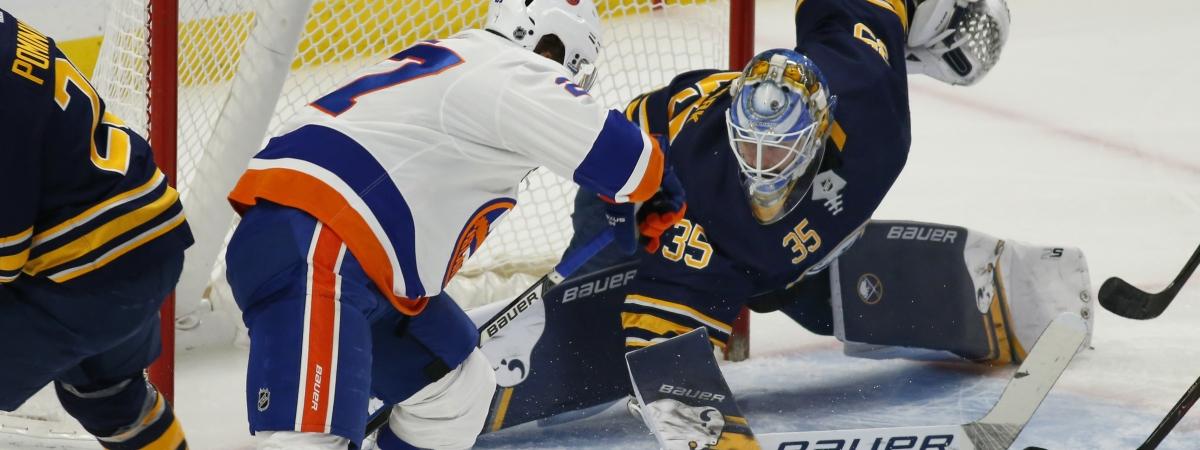 Islanders' Anders Lee battles Sabre goalie Linus Ullmark