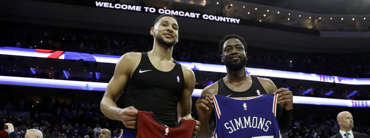 Philadelphia 76ers' Ben Simmons, left, and Miami Heat's Dwyane Wade pose after swapping jerseys Thursday, Feb. 21, 2019, in Philadelphia. (AP Photo/Matt Slocum)