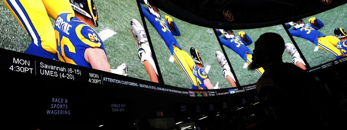A man watches Super Bowl LIII at the Westgate Superbook sports book in Las Vegas. (John Locher, File)