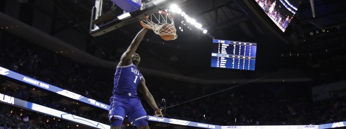 Duke's Zion Williamson  dunks against North Carolina  Friday (Chuck Burton)