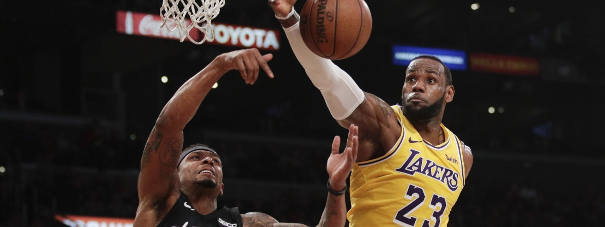 Los Angeles Lakers' LeBron James, right, grabs a rebound against Washington Wizards' Bradley Beal during the game on March 26, 2019, in Los Angeles.