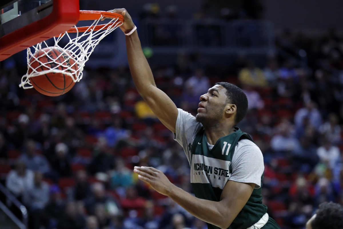 Michigan State forward Aaron Henry dunks  during practice Wednesday  (Charlie Neibergall)