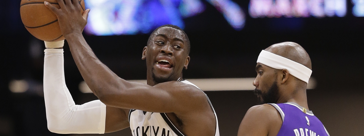 Brooklyn Nets guard Caris LeVert protects the ball from Sacramento Kings guard Corey Brewer during the game on March 19, 2019.