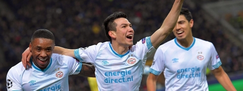 PSV's Hirving Lozano, center, celebrates after scoring a goal last year at the San Siro stadium in Milan, Italy on Dec. 11, 2018. ( via AP)