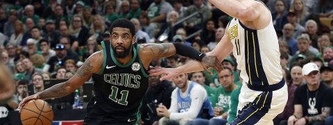 Boston Celtics' Kyrie Irving drives on Indiana Pacers' Domantas Sabonisn during the second quarter in Game 1 of a first-round NBA basketball playoff series, Sunday, April 14, 2019.