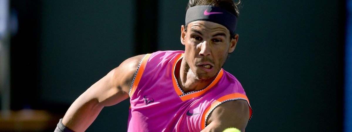 In this March 15, 2019, file photo, Rafael Nadal, of Spain, hits a volley to Karen Khachanov, of Russia, at the BNP Paribas Open tennis tournament in Indian Wells, California.