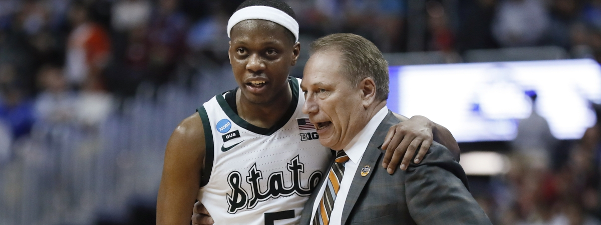 Michigan State guard Cassius Winston puts his arm around coach Tom Izzo following the team's 80-63 win over LSU in the NCAA men's college basketball tournament East Region semifinal on March 29, 2019.
