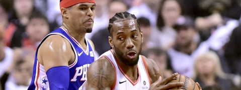 Philadelphia 76ers forward Tobias Harris, left, watches as Toronto Raptors forward Kawhi Leonard moves the ball during the first half of Game 1 of a second-round NBA basketball playoff series on April 27, 2019.