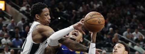 Denver Nuggets guard Gary Harris (14) is fouled by San Antonio Spurs guard DeMar DeRozan (10) during the first half of Game 6 of an NBA basketball playoff series, Thursday, April 25, 2019, in San Antonio. (AP Photo/Eric Gay)