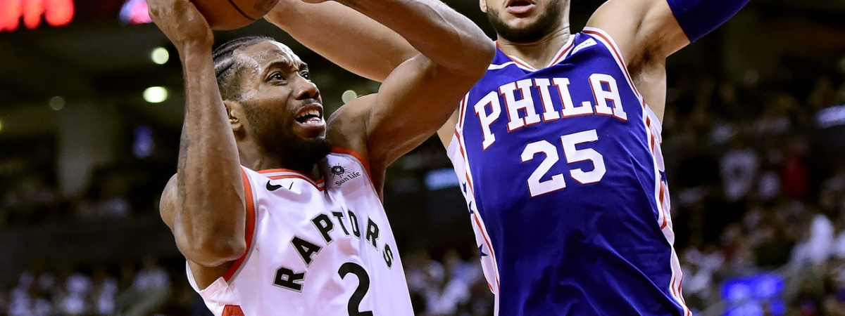 Toronto  forward Kawhi Leonard  looks for a shot against the Sixers' Ben Simmons in Game 1 on April 27  (Frank Gunn/The Canadian Press)