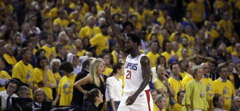 Clippers' Patrick Beverley celebrates in the final minutes of  Game 5  against the  Warriors on April 24 (Ben Margot)