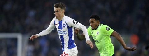 Brighton's Jamie Paterson (left) and Cardiff City's Nathaniel Mendez-Laing battle for the ball during the English Premier League soccer match  April 16 (Andrew Matthews)