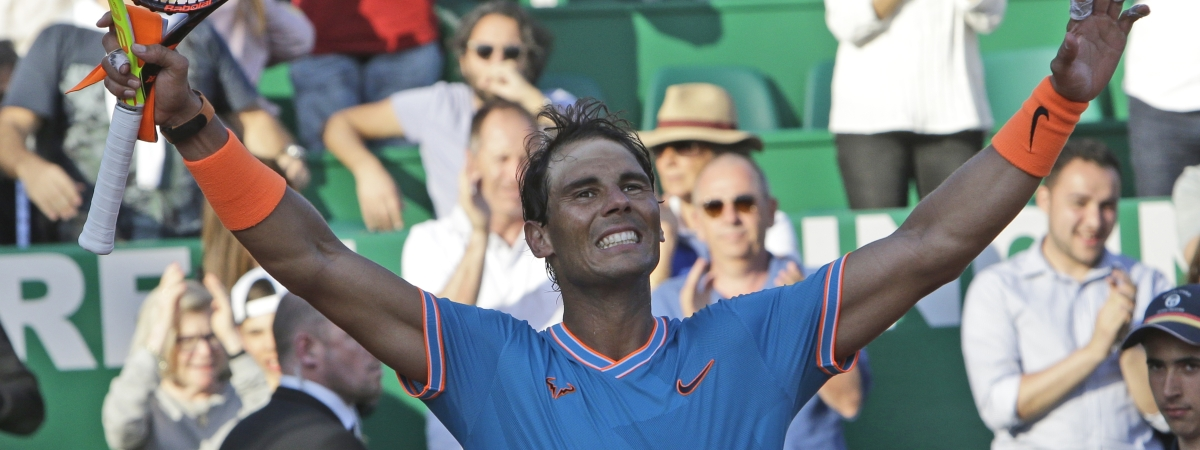 Spain's Rafael Nadal waves as he defeats Argentina's Guido Pella during their quarterfinal match of the Monte Carlo Tennis Masters tournament in Monaco, Friday, April 19, 2019. (AP Photo/Claude Paris)