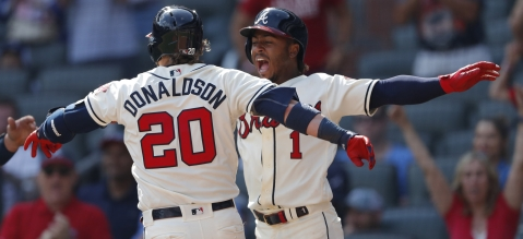 Braves third baseman Josh Donaldson (20) celebrates with Ozzie Albies after hitting a three-run home run in the eighth inning April 28 (John Bazemore)