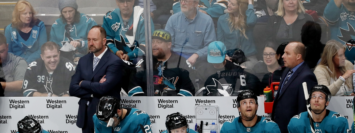 San Jose Sharks coach Peter DeBoer, left rear, stands in the bench area during the second period against the Vegas Golden Knights in Game 2 of an NHL hockey first-round playoff series on April 12, 2019.