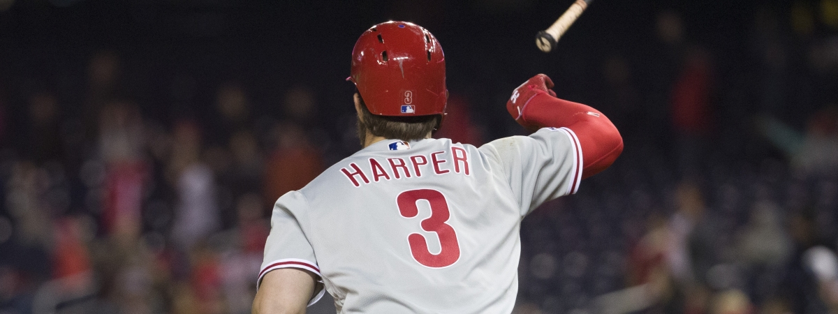 Philadelphia Phillies' Bryce Harper flips his bat after hitting a two-run homer in the eighth inning of a baseball game against the Washington Nationals at Nationals Park on April 2, 2019.