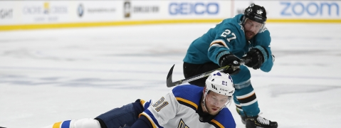 St. Louis Blues' Vladimir Tarasenko (91) battles for the puck against San Jose Sharks' Joonas Donskoi (27) in the second period in Game 1 of the NHL hockey Stanley Cup Western Conference finals in San Jose, Calif., on Saturday, May 11, 2019. (AP Photo/Josie Lepe)