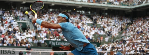 In this June 10, 2018 photo, Spain's Rafael Nadal returns the ball to Austria's Dominic Thiem during the men's final match of the French Open tennis tournament at the Roland Garros stadium in Paris.