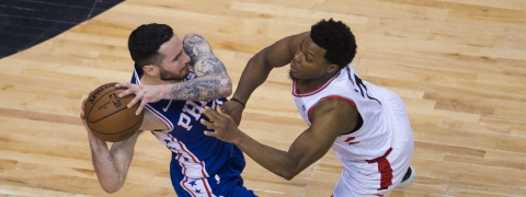 Philadelphia 76ers guard JJ Redick keeps the ball from Toronto Raptors guard Kyle Lowry during Game 5 of the NBA basketball second-round playoff series on May 7, 2019.