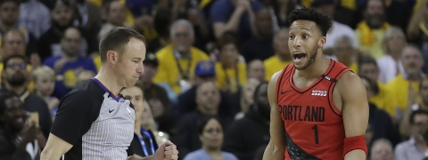 Portland Trail Blazers guard Evan Turner (1) gestures while talking to an official during the second half of Game 2 of the team's NBA basketball playoffs Western Conference finals against the Golden State Warriors in Oakland, Calif., Thursday, May 16, 2019. (AP Photo/Jeff Chiu)