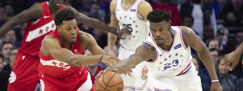 Sixers' Jimmy Butler (right) and Raptors' Kyle Lowry battle for a loose ball in Game 4 on May 5 (Chris Szagola)