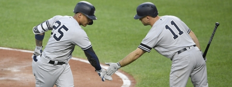Yankees' Gleyber Torres (left) celebrates his home run with third base coach Phil Nevin on  May 22 (Nick Wass)