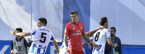 Real Sociedad's Mikel Merino, right, celebrates after scoring his side's opening goal as Real Madrid's Toni Kroos, centre, reacts during the Spanish La Liga soccer match between Real Sociedad and Real Madrid on May 12, 2019.