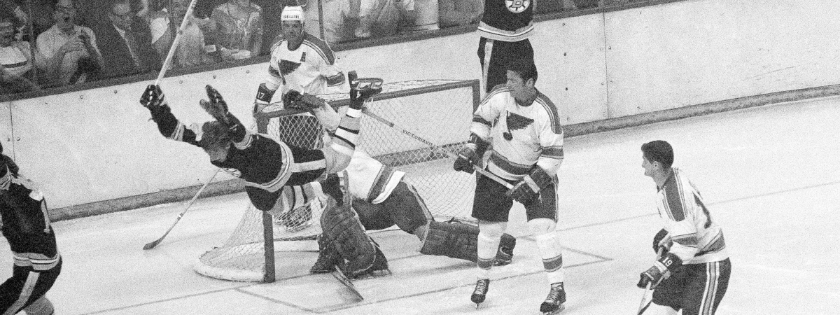 FILE - In this May 10, 1970, file photo, Boston Bruins' Bobby Orr flies through the air after driving the winning goal past St. Louis Blues' goalie Glenn Hall in the sudden death period of their NHL finals of the Stanley Cup Series, in Boston Garden. Orr and the big, bad Boston Bruins swept the expansion-era Blues in that series. Now 49 years later, Boston is in its third final in nine seasons and St. Louis is back for the first time since 1970. (AP Photo/A.E. Maloof)