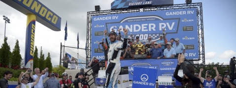 Driver Martin Truex Jr. (19) celebrates in victory lane after winning the NASCAR Cup Series auto race, Monday, May 6, 2019, at Dover International Speedway. He was doubly excited that Mark Eckel had him as one of his picks, (AP Photo/Will Newton)