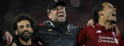 Liverpool's Mohamed Salah, left, manager Jurgen Klopp, center, and Virgil van Dijk celebrate after the Champions League Semi Final, second leg soccer match between Liverpool and Barcelona on May 7, 2019.
