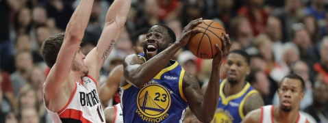 Golden State Warriors forward Draymond Green shoots against Portland Trail Blazers forward Meyers Leonard, left, during the first half of Game 3 of the NBA basketball playoffs Western Conference finals on May 18, 2019.