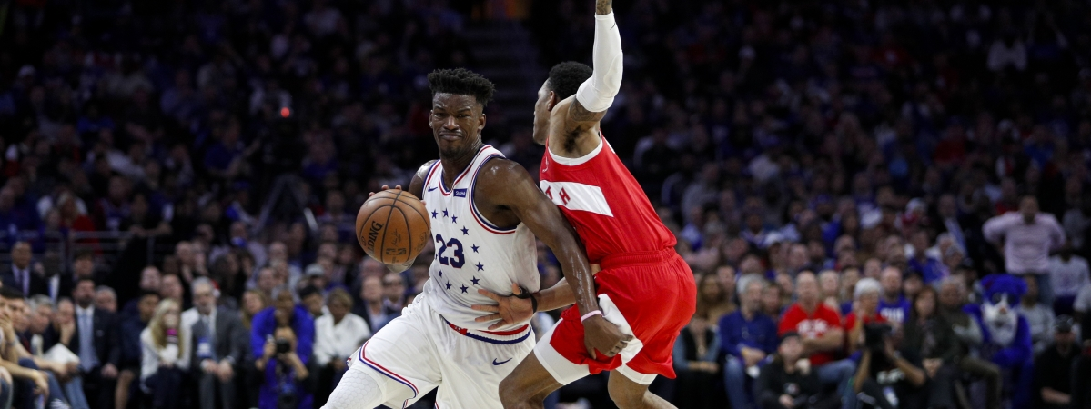 Philadelphia 76ers' Jimmy Butler, left, tries to get past Toronto Raptors' Patrick McCaw during the first half of Game 6 of a second-round NBA basketball playoff series on May 9, 2019.